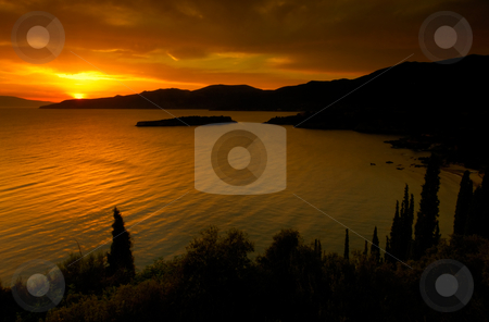 Golden sunset in Kardamili stock photo, Picture shows a spectacular sunset over the bay of Kardamili, southern Greece by Andreas Karelias