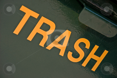 The Word Trash Diagonally stock photo, The word trash is written and laid out in a diagonal pattern against a green metal background. by Valerie Garner