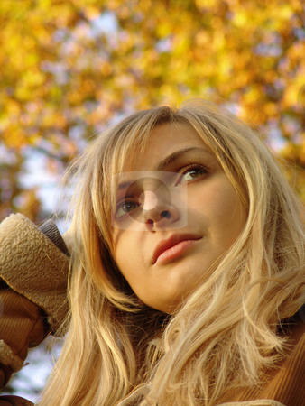 Bright colors of the Autumn  stock photo, The bright colours of the late autumn contrasting with the beauty of the nice blond model.    Was shot in Russia in 09.10.2004 at sunrise. by Sergey Kuznetsov