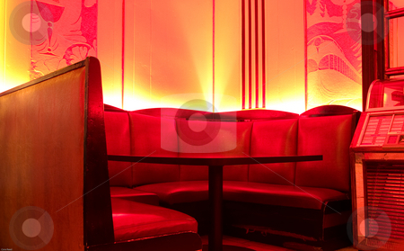 Red Booth stock photo, A vintage booth with red ambient light by Cora Reed