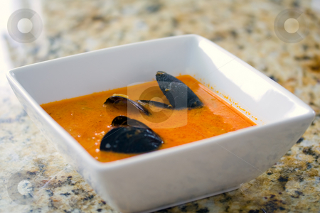 Mussel soup stock photo, Fresh mussel soup in a white bowl on a granite countertop by Natalia Banegas