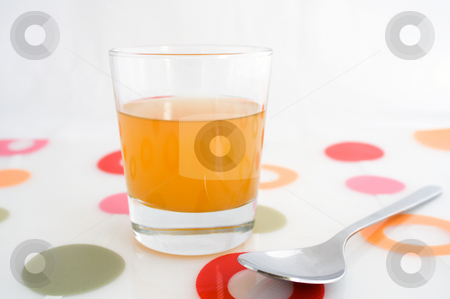 Glass of apple cider vinegar stock photo, A glass of raw, unfiltered apple cider vinegar, with