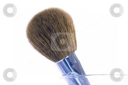 Make-up brush in a glass stock photo, Big make-up brush in a glass. Isolated on white background. by Natalia Banegas