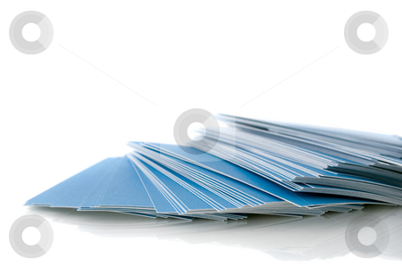 Pile of blue business cards stock photo, Pile of blue business cards, isolated on white background, with shadow by Natalia Banegas