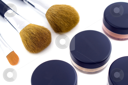 Make-up brushes and powder jars stock photo, A set of three make-up brushes and four jars with mineral powder foundation. Isolated on white background, with shadow. by Natalia Banegas