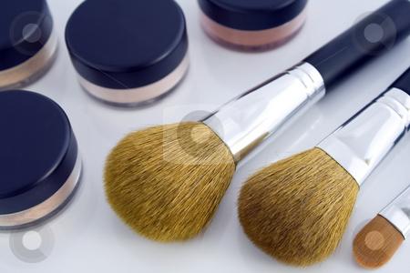 Make-up brushes and powder jars stock photo, A set of three make-up brushes and four jars with mineral powder foundation. by Natalia Banegas