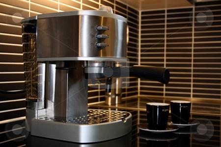 Espresso machine with two espresso cups stock photo, Espresso machine in stainless steel with two dark brown cups by Natalia Banegas