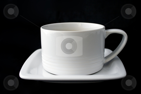 White coffee cup and plate on black background stock photo, White coffee cup and plate isolated on black background by Natalia Banegas