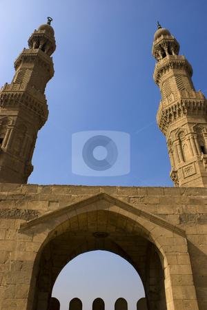 The Minarets of Zuweila stock photo, Bab Zuweila is a medieval gate in Cairo, which is still standing in modern times. It was also known as Bawabbat Al-Mitwali during the Ottoman period, and is sometimes spelled Bab Zuwayla. It considered the last remaining southern gate from the walls of Fatimid Cairo in the 11th and 12th century. Its name comes from Bab, meaning