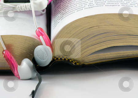 Bible and Headphones stock photo, Today, more people are using modern technology to study the Bible, such as downloading audio versions by Jim Larranaga