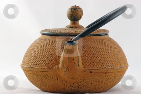 Tea Pot stock photo, An iron tea pot ready to brew. by Jim Larranaga