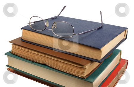 Glasses and books. stock photo, Glasses and books. Close-up. Isolated on white. by Andrey Khritin