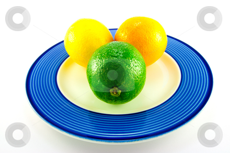Lemon, Lime and Orange on a Plate stock photo, Single whole lemon, lime and orange on a blue plate with a white background by Keith Wilson