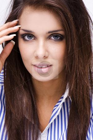 Beauty brunette stock photo, Beauty brunette woman face with blue eyes and blue shirt, by Piotr Stryjewski