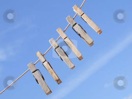Cloth Peg's with Blue Sky Background stock photo, Cloth Peg's with Blue Sky Background by Stephen Lambourne