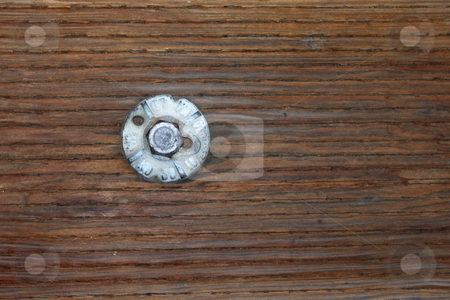 Bolt stock photo, Weathered bolt in a piece of timber from a wooden pier by Henrik Lehnerer