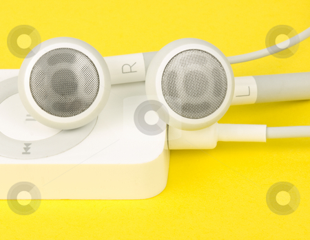 Earbuds with MP3 Player stock photo, Earbuds with MP3 Player on yellow background by John Teeter