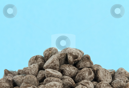Pile of chocolate chips stock photo, Pile of chocolate chips with copy space by John Teeter