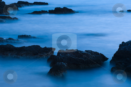 Rocks in blue stock photo, Picture of sea rocks at low light by Andreas Karelias