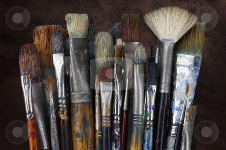 Artist's still life stock photo, Close up of artist's paint brushes with a dark textured background by James Barber