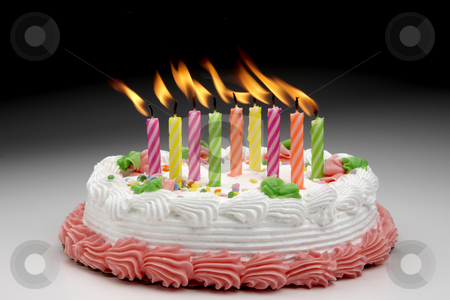 Happy Birthday! stock photo, Birthday cake with colorful lit candles by James Barber