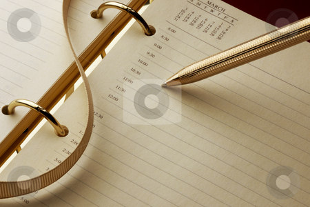 Writing in diray stock photo, Gold pen about to write in diary by James Barber