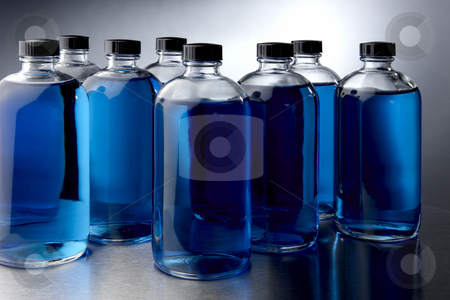 Blue chemicals stock photo, Glass bottles filled with blue liquids by James Barber