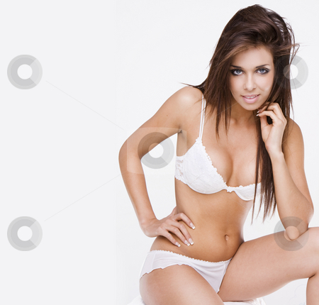 Young Brunette Girl stock photo, Young brunette sitting in a white bikini by Piotr Stryjewski