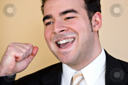 Happy Business Man stock photo, A happy business man holding his fist up in the air in victory. by Todd Arena
