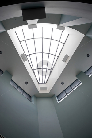 Modern Architectural Interior stock photo, A modern architectural interior with a triangular shaped skylight. by Todd Arena