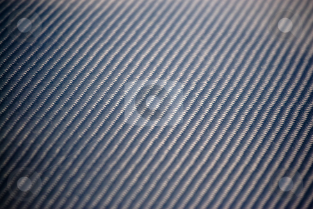 Real Carbon Fiber stock photo, A closeup of real carbon fiber material.  This makes an excellent texture or background.  Shallow depth of field. by Todd Arena