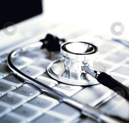 Silver stethoscope over laptop keyboard stock photo, Silver stethoscope over laptop keyboard by Paul Hill