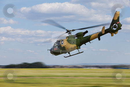 Helicopter stock photo, Army helicopter flying low at high speed by Steve Mcsweeny