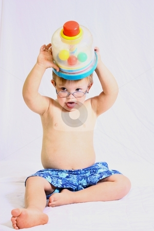 Little boy with glasses playing with toy. stock photo, Little boy playing with toy by Gregory Dean