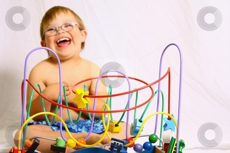 Little boy with glasses playing with toy. stock photo, Little boy with toy by Gregory Dean