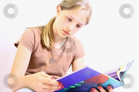 Young cute girl with blond hair reading book. stock photo, Young reading book by Gregory Dean