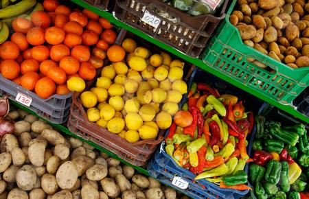 Fruit and vegetable stand stock photo, Image shows a fruit and vegetable market stand by Andreas Karelias