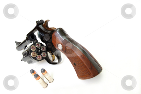 38 Caliber Revolver And Ammunition stock photo, 38 special handgun, the cylinder loaded with copper jacketed, hollow point bullets on a white background. by Lynn Bendickson