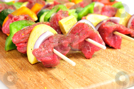 Steak Shish Kabob stock photo, Steak and assoretd vegetables including onion, orange and green bell peppers and summer squash on bamboo skewer sprinkled spices ready for the gril. by Lynn Bendickson