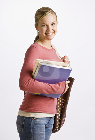 Woman carrying bag and books stock photo, Woman carrying bag and books by Jonathan Ross
