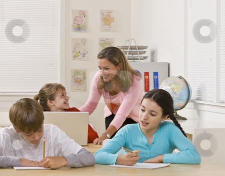 Teacher helping student stock photo, Teacher helping student by Jonathan Ross