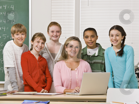 Teacher posing with students stock photo, Teacher posing with students by Jonathan Ross