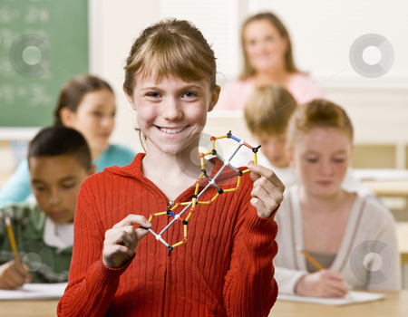 Student holding helix in classroom stock photo, Student holding helix in classroom by Jonathan Ross