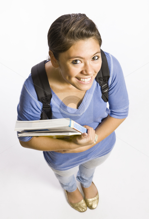 Student wearing backpack carrying books stock photo, Student wearing backpack carrying books by Jonathan Ross