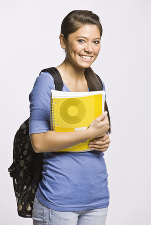 Student carrying backpack and notebook stock photo, Student carrying backpack and notebook by Jonathan Ross