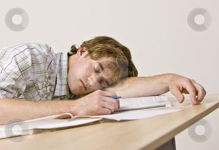 Student sleeping at desk in classroom stock photo, Student sleeping at desk in classroom by Jonathan Ross
