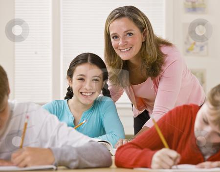 Teacher helping student in classroom stock photo, Teacher helping student in classroom by Jonathan Ross