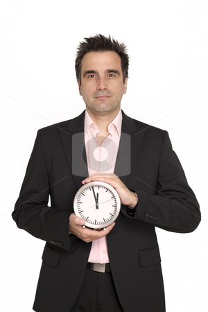 Businessman hold a big clock stock photo, Businessman with black suit hold in front of him, a silver metal wall clock by Marios Karampalis