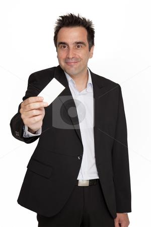 Businessman hold his personal card stock photo, Businessman offers his personal card with grin by Marios Karampalis