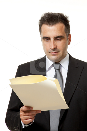 Businessman with document stock photo, Businessman reads a document with query by Marios Karampalis